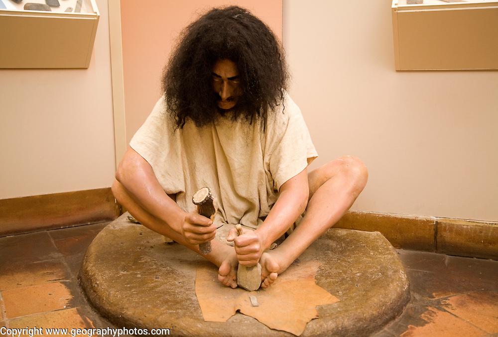 Prehistoric Stone Age people display in the municipal city museum, Ronda, Spain