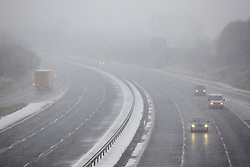 © Licensed to London News Pictures.  18/01/2013. OXFORD, UK. General view of snowy conditions on the M40 motorway near Oxford. The Met Office has issued an amber warning for heavy snow for a large part of England. Photo credit :  Cliff Hide/LNP