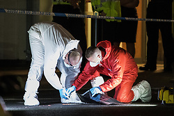 © Licensed to London News Pictures. 10/08/2017. Salford, UK. Forensic examiners examine the scene in a car park at the rear of the Ibis Hotel in Salford Quays where a young boy was killed in a collision with a car earlier this evening (Thursday 10th August 2017) . Photo credit: Joel Goodman/LNP