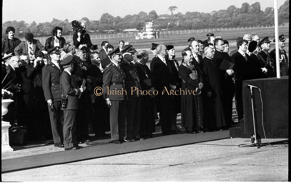 Pope John-Paul II visits Ireland..1979..29.09.1979..09.29.1979..29th September 1979..Today marked the historic arrival of Pope John-Paul II to Ireland. He is here on a three day visit to the country with a packed itinerary. He will celebrate mass today at a specially built altar in the Phoenix Park in Dublin. From Dublin he will travel to Drogheda by cavalcade. On the 30th he will host a youth rally in Galway and on the 1st Oct he will host a mass in Limerick prior to his departure from Shannon Airport to the U.S..A view of some of the VIP's who were on hand to welcome the Pope tro Ireland.