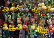 Pineapples,oranges, and other fruit for sale, at Lakeside, in Pokhara, Nepal.