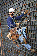 Construction Worker Hanging On Rebar