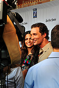 "Matthew McConaughey and girlfriend Camila Alves at the premiere of Surfer Dude, Austin Texas, September 3 2008. Surfer Dude stars Matthew McConaughey with Alexie Gilmore in a ""wave twisting tale of a soul searching surfer experiencing an existential crisis."" Matthew McConaughey (b. November 4, 1969 in Uvalde, Texas) is an American actor whose breakout role came in Dazed and Confused (1993). Matthew McConaughey and Camila Alves are the parents of an 8-week-old boy, Levi."