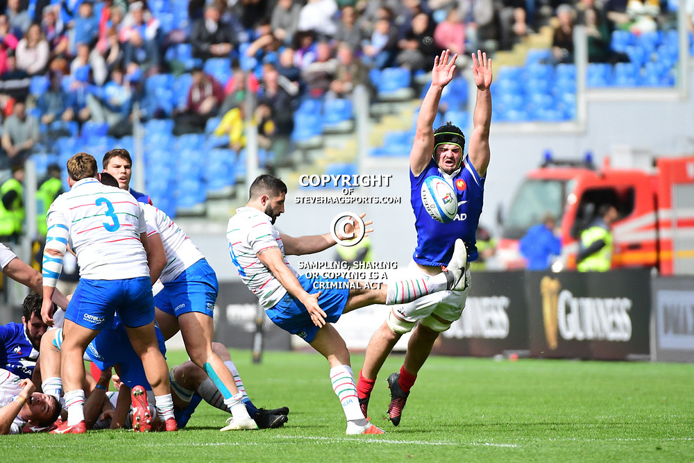 (R-L) Gregory Alldritt of France tries to charge down a kick from Tito Tebaldi of Italy during the Guinness Six Nations match between Italy and France on March 16, 2019 in Rome, Italy. (Photo by Dave Winter/Icon Sport)