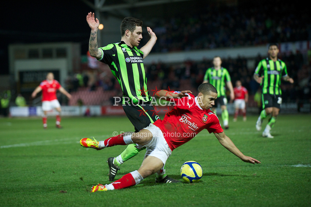 WREXHAM, WALES - Wednesday, january 18, 2012: Wrexham's Curtis Obeng in action against Brighton & Hove Albion's Romain Vincelot during the FA Cup 3rd Round Replay match at the Racecourse Ground. (Pic by David Rawcliffe/Propaganda)