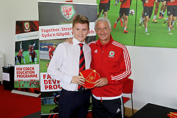 NEWPORT, WALES - Sunday, May 28, 2017: Car Powell-Roberts receives a cap from Elite Performance Director Ian Rush for participation during day three of the Football Association of Wales' National Coaches Conference 2017 at Dragon Park. (Pic by Mark Roberts/Propaganda)