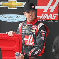 Driver Kurt Busch is seen in the pit area during the first practice session of the 56th Annual NASCAR Coke Zero400 race at Daytona International Speedway on Thursday, July 3, 2014 in Daytona Beach, Florida.  (AP Photo/Alex Menendez)