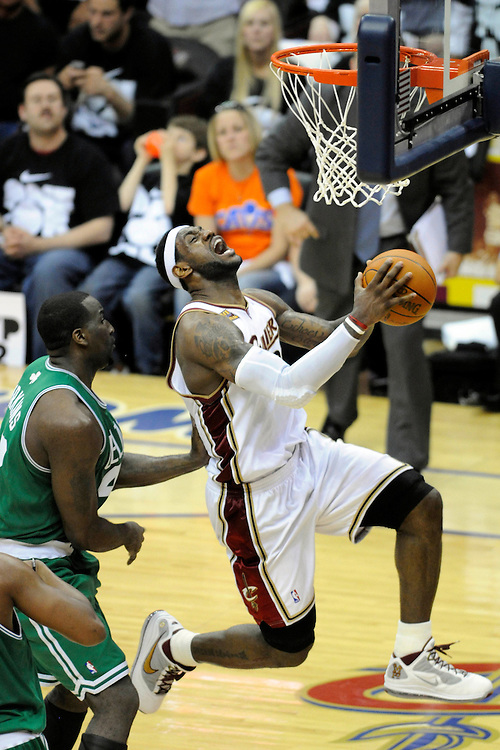 May 3, 2010; Cleveland, OH, USA; Cleveland Cavaliers forward LeBron James (23) tries to shoot over Boston Celtics center Kendrick Perkins (43) during the fourth quarter of game two in the eastern conference semifinals in the 2010 NBA playoffs at Quicken Loans Arena. The Celtics beat the Cavaliers 104-86. Mandatory Credit: Jason Miller-US PRESSWIRE