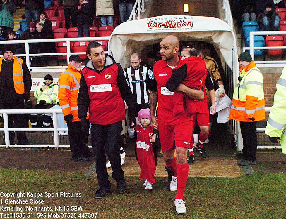LEON MCKENZIE, CAPTAINS AND BRINGS OUT THE TEAMS WITH HIS CHILDREN FOR HIS LAST GAME, BEFORE RETIRING FROM FOOTBALL, Kettering Town v Bath City, Blue Square Premier, Nene Park, Saturday 17th December 2011