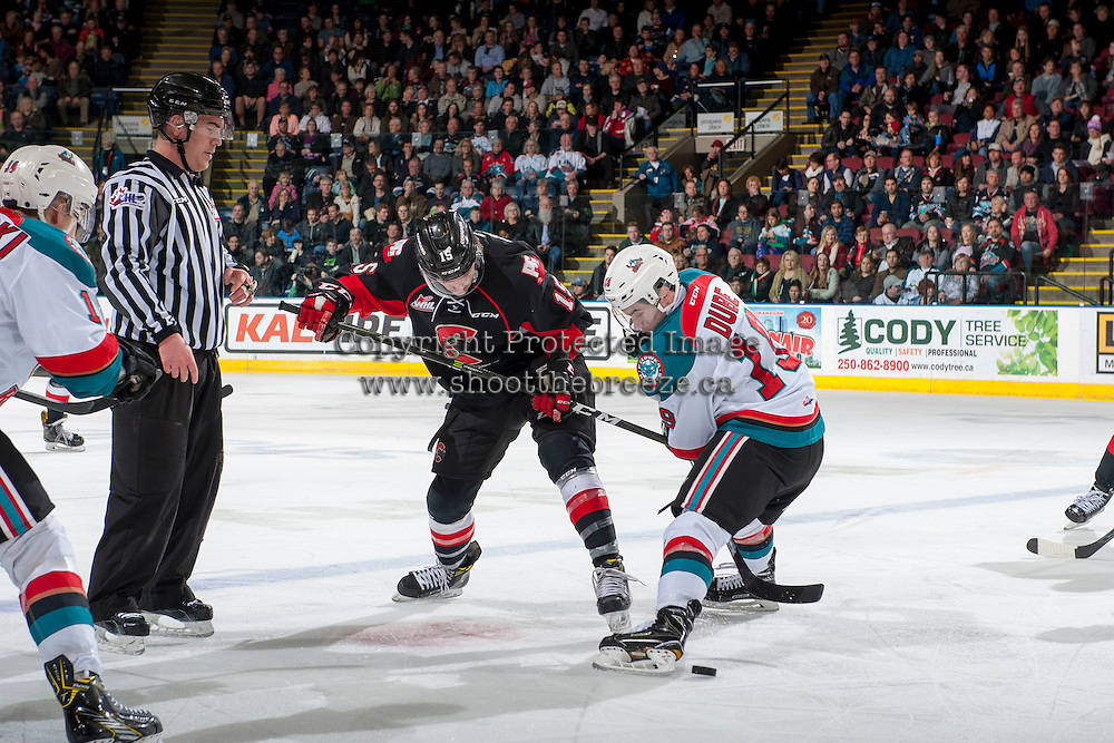 KELOWNA, CANADA - FEBRUARY 18: Dillon Dube #19 of the Kelowna Rockets wins the face off against Shane Collins #19 of the Prince George Cougars during first period on February 18, 2017 at Prospera Place in Kelowna, British Columbia, Canada.  (Photo by Marissa Baecker/Shoot the Breeze)  *** Local Caption ***
