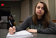 Ohio University student Paige Ludwin poses for a portrait with a special pen that she uses to record lectures as she takes notes.