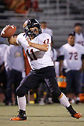 Woodside quarterback Robert Wang (11) throws the ball to an open receiver against Milpitas High School at Milpitas High School in Milpitas, California, on September 13, 2013. The Trojans went on to beat the Wildcats 50-6. (Stan Olszewski/SOSKIphoto)