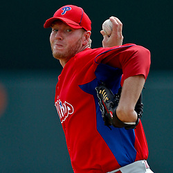 March 20, 2012; Sarasota, FL, USA; Philadelphia Phillies starting pitcher Roy Halladay (34) throws against the Baltimore Orioles during a spring training game at Ed Smith Stadium.  Mandatory Credit: Derick E. Hingle-US PRESSWIRE