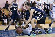 Jordyn James of Brighton, left, tries to keep the ball away from Mary Bayer of Pittsford Sutherland, right, during a game at Brighton High School on Thursday, January 21, 2016.
