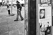 Downtown Juarez and a vandalized poster on a phone booth asking for information on the disappearance of Iliana Carillo, who went missing in 2014 at the age of 23. Ciudad Juarez, Mexico. Sept. 28, 2014. (Photo by Gabriel Romero ©2014)