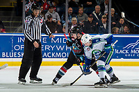 KELOWNA, CANADA - OCTOBER 23:  Kyle Topping #24 of the Kelowna Rockets faces off against Ethan Regnier #18 of the Swift Current Broncos during second period on October 23, 2018 at Prospera Place in Kelowna, British Columbia, Canada.  (Photo by Marissa Baecker/Shoot the Breeze)