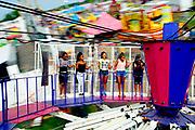 From left, Jenelle Palmer, 12, Jayla Myrick, 13, Sareena Barnes, 12, Katherine Zepeda, 13, and Asha Martin, 13, all of Manassas, spin around on a ride at the Prince William County Fair. The girls spent the day at the fair in celebration of Katherine's 13th birthday.