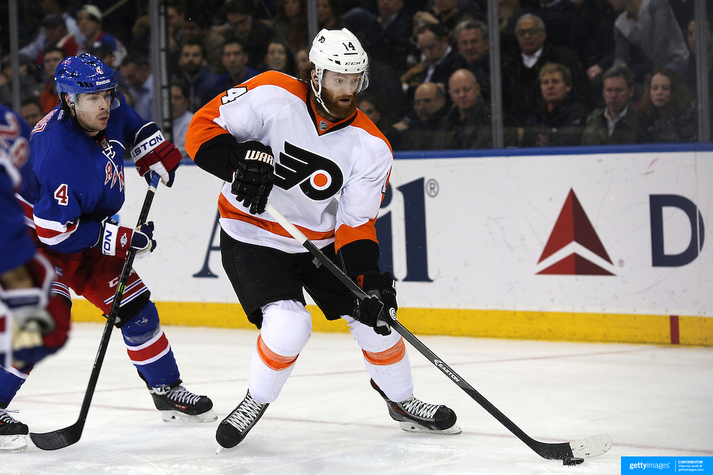Sean Couturier, (right), Philadelphia, Flyers, in action during the New York Rangers Vs Philadelphia Flyers, NHL regular season game at Madison Square Garden, New York, USA. 26th March 2014. Photo Tim Clayton