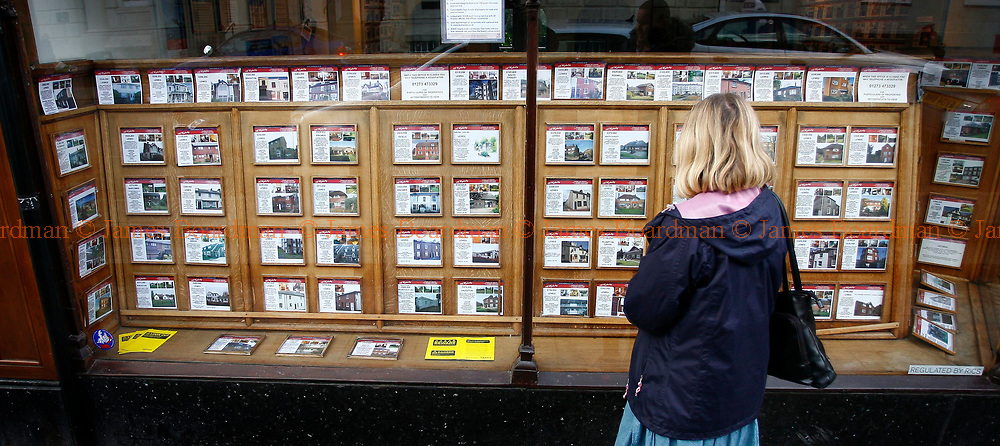 JAMES BOARDMAN / 07967642437<br /> A woman look at Propertys for sale in an estate agents window Febuary 25, 2008.