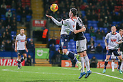 Bolton Wanderers striker Gary Madine  held by Brentford defender Jack O'Connell  during the Sky Bet Championship match between Bolton Wanderers and Brentford at the Macron Stadium, Bolton, England on 30 November 2015. Photo by Simon Davies.
