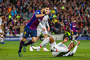 Barcelona forward Luis Suárez (9) pulls over Liverpool defender Joel Matip (32) during the Champions League semi-final leg 1 of 2 match between Barcelona and Liverpool at Camp Nou, Barcelona, Spain on 1 May 2019.