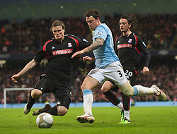 MANCHESTER, ENGLAND - Sunday, February 13, 2010: Manchester City's Wayne Bridge in action against Stoke City during the FA Cup 5th Round match at the City of Manchester Stadium. (Photo by David Rawcliffe/Propaganda)  MANCHESTER, ENGLAND - Sunday, February 13, 2010: Manchester City xxxx and Stoke City's xxxx during the FA Cup 5th Round match at the City of Manchester Stadium. (Photo by David Rawcliffe/Propaganda)