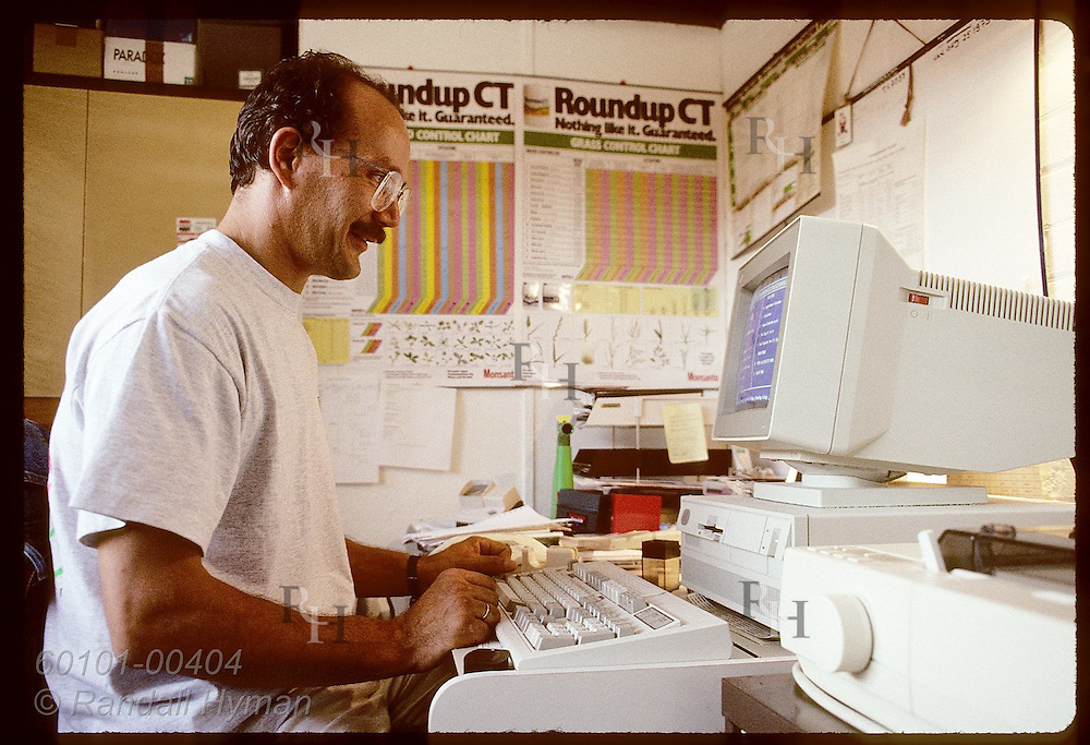 Zel Bodulovic, at computer in home office, develops and markets agricultural chemicals;Wagga,NSW Australia