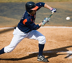Virginia Cavaliers outfielder Mike Mitchell (5) attempts a bunt against Delaware.  The Virginia Cavaliers Baseball Team defeated the Delaware Blue Hens 3-2 to complete the sweep of a three game series at Davenport Field in Charlottesville, VA on March 4, 2007.