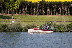 Hambleden Lock, Buckinghamshire, England. Actor, comedian and political activist Russell Brand is spotted taking his girlfriend Laura Gallacher for a boat ride along the River Thames at Hambleden. He later is alleged to have assaulted the photographer and robbed him of his spectacles, demanding that the pictures be deleted. Photographers are under no obligation to delete pictures taken of people in public. &copy;Paul Davey<br /> FOR LICENCING CONTACT: Paul Davey +44 (0) 7966 016 296 paul@pauldaveycreative.co.uk