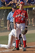Nebraska third baseman Steve Edlefsen (9) reacts after making a bad throw to first, allowing Kansas State to have runners at first and third in the bottom of the seventh.  Nebraska held on to be Kansas State 5-4 at Tointon Stadium in Manhattan, Kansas, April 1, 2006.