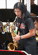Saxophone player Elaine Yuzuriha performs with the Minidoka Swing Band on the grounds of Washington Country Museum, Hillsboro, Oregon