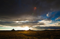 Rain falling from the sky as the sun sets over Canyonlands national Park in Southeast Utah, USA.
