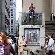 A street scene near the The Bronze statue of George Washington on the front steps of Federal Hall in Wall Street, Downtown Manhattan, New York City, USA. 16th September 2014. Photo Tim Clayton