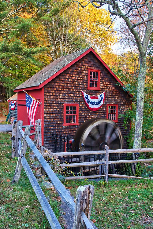 The Medfield Kingsbury Grist Mill in Massachusetts on a beautiful autumn picture perfect day. This is a more intimate view of this historic watermill. The warm light painted the fall foliage tree canopy in gorgeous colors which stand in nice contrast with the historic landmark rotating waterwheel.<br /> <br /> Kingsbury Grist Mill in Medfield, MA photography images are available as museum quality photo, canvas, acrylic, wood or metal prints. Wall art prints may be framed and matted to the individual liking and interior design decoration needs:<br /> <br /> https://juergen-roth.pixels.com/featured/medfield-kingsbury-grist-mill-juergen-roth.html<br /> <br /> Good light and happy photo making!<br /> <br /> My best,<br /> <br /> Juergen<br /> Licensing: http://www.rothgalleries.com<br /> Photo Prints: http://fineartamerica.com/profiles/juergen-roth.html<br /> Photo Blog: http://whereintheworldisjuergen.blogspot.com<br /> Instagram: https://www.instagram.com/rothgalleries<br /> Twitter: https://twitter.com/naturefineart<br /> Facebook: https://www.facebook.com/naturefineart
