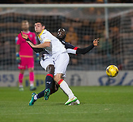 Dundee&rsquo;s Kevin Gomis tackles Partick Thistle&rsquo;s Kris Doolan - Dundee v Partick Thistle in the Ladbrokes Scottish Premiership at Dens Park, Dundee. Photo: David Young<br /> <br />  - &copy; David Young - www.davidyoungphoto.co.uk - email: davidyoungphoto@gmail.com