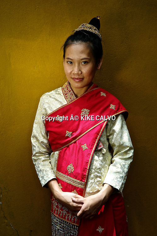 Teen girl wearing a Lao Lom wedding dress.
