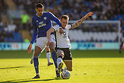 Robert Glatzel of Cardiff City challenges Ben Wilmot of Swansea City during the EFL Sky Bet Championship match between Cardiff City and Swansea City at the Cardiff City Stadium, Cardiff, Wales on 12 January 2020.