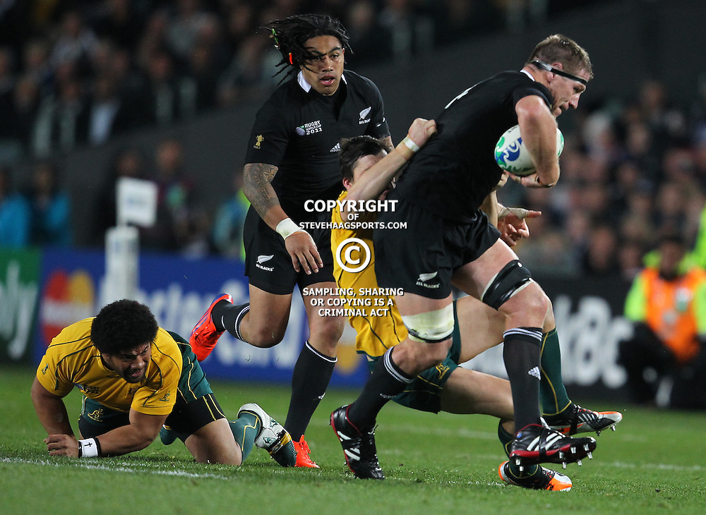 AUCKLAND, NEW ZEALAND - OCTOBER 16, Adam Ashley-Cooper looks to make a tackle on Brad Thorn during the 2011 IRB Rugby World Cup Semi Final match between New Zealand and Australia at Eden Park on October 16, 2011 in Auckland, New Zealand<br /> Photo by Steve Haag / Gallo Images