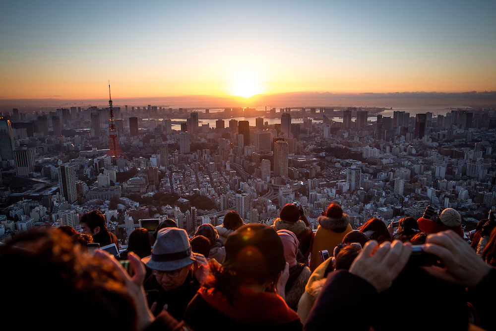 TOKYO, JAPAN - JANUARY 1 : People gather to look at the view of the New Year's first sunrise on January 1, 2017, from the top of the observation deck of MORI building in central Tokyo, Japan. (Photo by Richard Atrero de Guzman/NURPhoto)