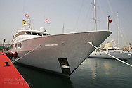 Luxury yacht sits tied up at superyacht marina in Port America's Cup; Valencia, Spain.