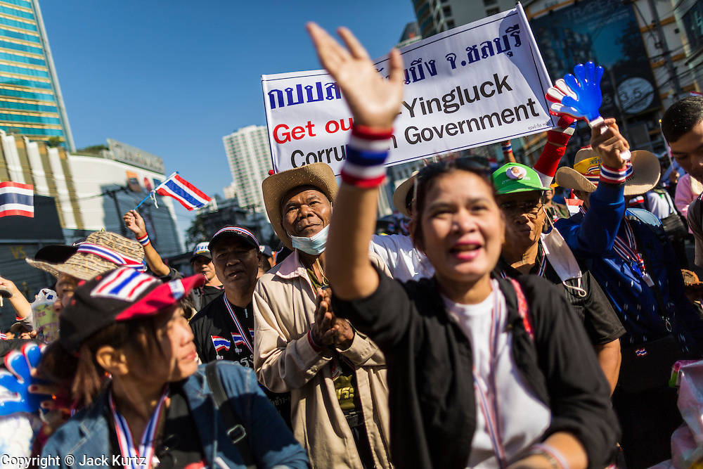 "15 JANUARY 2014 - BANGKOK, THAILAND:  Anti-government protestors gather at the stage in the Asoke intersection for Shutdown Bangkok. Tens of thousands of Thai anti-government protestors continued to block the streets of Bangkok Wednesday to shut down the Thai capitol. The protest, ""Shutdown Bangkok,"" is expected to last at least a week. Shutdown Bangkok is organized by People's Democratic Reform Committee (PRDC). It's a continuation of protests that started in early November. There have been shootings almost every night at different protests sites around Bangkok. The malls in Bangkok are still open but many other businesses are closed and mass transit is swamped with both protestors and people who had to use mass transit because the roads were blocked.   PHOTO BY JACK KURTZ"