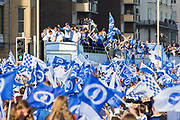 Brighton players on on top bus with fans and flags during the Brighton & Hove Albion Football Club Promotion Parade at Brighton Seafront, Brighton, United Kingdom on 14 May 2017. Photo by Phil Duncan.