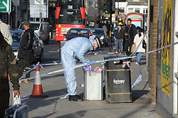 © Licensed to London News Pictures. 22/12/2018. London UK: Police and forensic officers at the scene of a fatal stabbing in Tottenham high road. A male in his twenties was found in Albert Place near the high road with stab wounds and rushed to an east London hospital where he died at around 2.15 this morning , Photo credit: Steve Poston/LNP