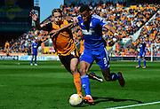 Dave Edwards tracks down Tyrone Mings during the Sky Bet Championship match between Wolverhampton Wanderers and Ipswich Town at Molineux, Wolverhampton, England on 18 April 2015. Photo by Alan Franklin.
