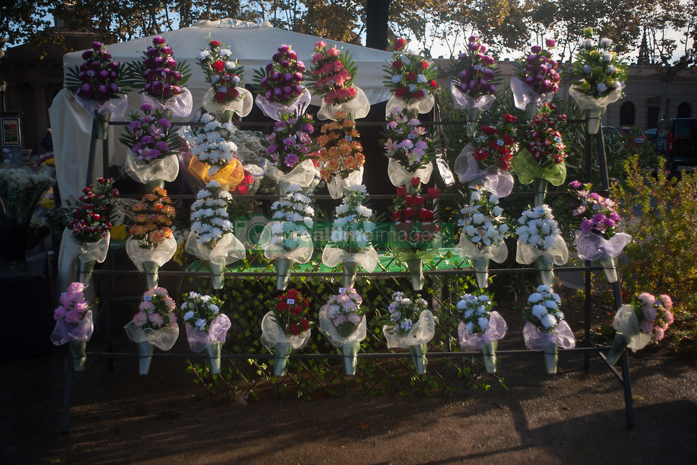 November 1, 2018 - Barcelona, Catalonia, Spain - Bouquets of flowers exposed at the entrance of the Poblenou cemetery in Barcelona, Catalonia, Spain, on November 1, 2018. All Saints Day, the traditional catholic feast dedicated to the memory of the ancestors, is celebrated the day of November 1 and people visit the cemeteries to remember the missing loved ones and place flowers in his graves. (Credit Image: © Jordi Boixareu/NurPhoto via ZUMA Press)