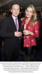 Jockey RICHARD DUNWOODY and MISS GEORGIA BLAKEY, at an award ceremony on 12th March 2002.OYG 213