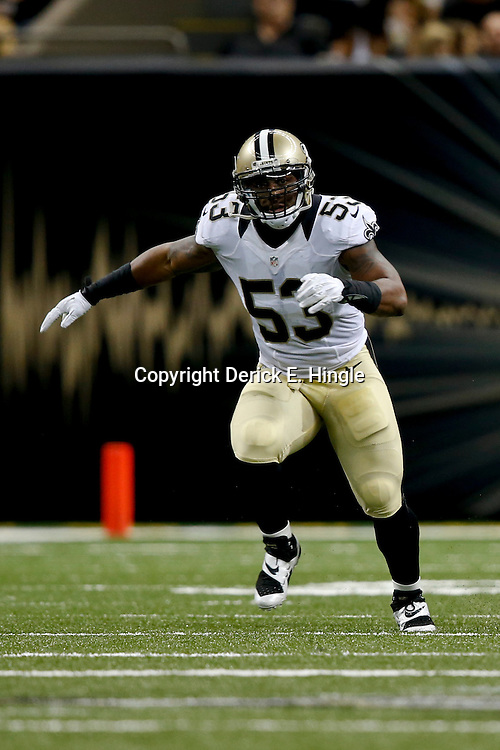 Aug 9, 2013; New Orleans, LA, USA; New Orleans Saints linebacker Ramon Humber (53) against the Kansas City Chiefs during a preseason game at the Mercedes-Benz Superdome. The Saints defeated the Chiefs 17-13. Mandatory Credit: Derick E. Hingle-USA TODAY Sports
