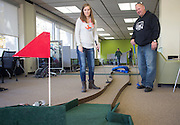Emily Little, left, and her dad Dwayne Little, of Columbus, Ohio, play mini golf in Alden during Dad's Weekend on November 5, 2016.