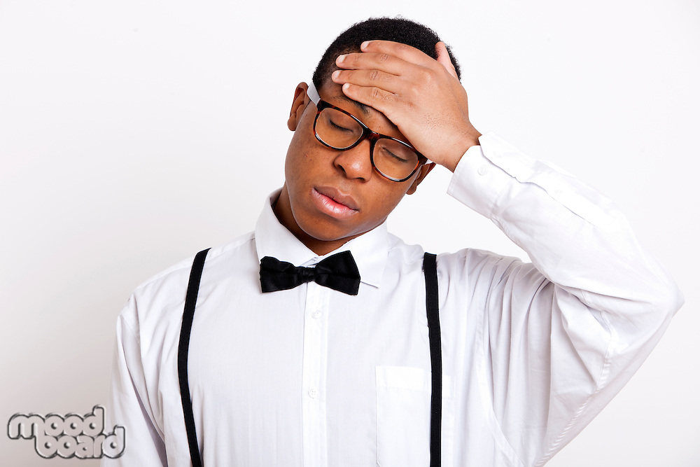 Young man suffering from headache over white background