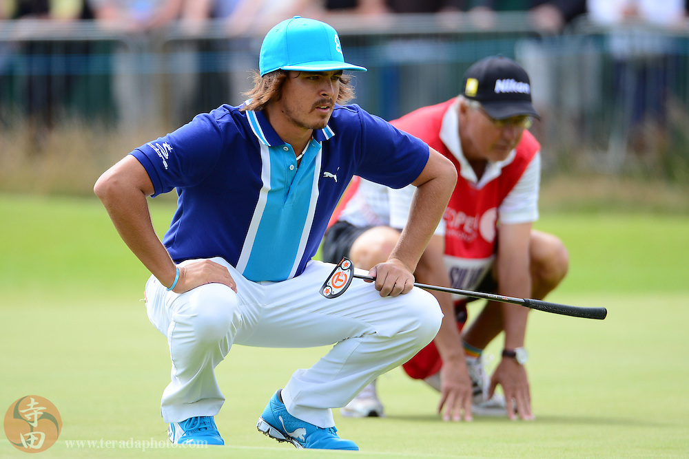 July 21, 2012; St. Annes, ENGLAND; Rickie Fowler (left) lines up his putt on the 18th hole during the third round of the 2012 British Open Championship at Royal Lytham & St. Annes Golf Club.